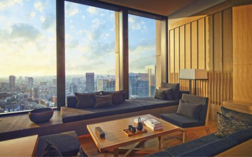 東京を俯瞰で見渡せるようなパノラミックな景色が楽しめるプレミアルームのリビングエリア